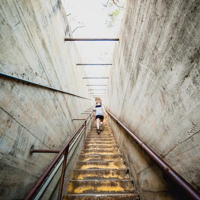 Woman climbing staircase